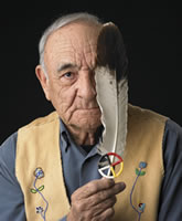 elder with a feather